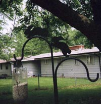 My bird-feeder hook, with running rabbits on top